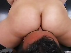 Tattooed bootylicious blonde with gloves sits on hunks face