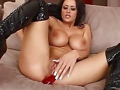 Stunning brunette with big tits in boots sticks dildo in her asshole
