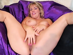 Buxom chubby busty mature amateur MILF Danielle strips at home