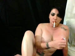 Stacked milf smokes a cigarette and gets her cunt devoured