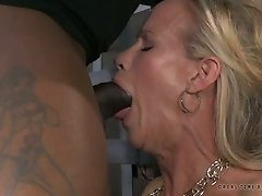 Bosomy slave makes that chocolate cock disappear down her throat