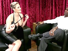 Perfectly shaped mistress Ryan Keely fucks anal hole of suspended black submissive