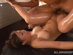 Japanese babe with natural tits gets oiled and drilled in MMF threesome