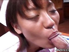 Giggling short haired Japanese nurse Reimi Aoi gets bushy pussy fingered