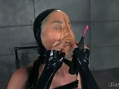 Restrained brunette with big boobs gets her muff examined by horny latex chick