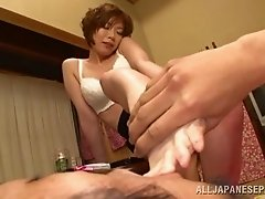 An Asian MILF gets so turned on from a toe sucking that she gives head