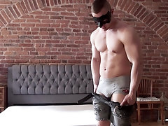 Buffed blonde gay dude masturbates and cums solo wearing a mask