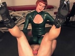 Trampling redhead dominatrix in latex
