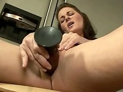 Incredibly hot busty whore Bella Roxxx has a dildo for drilling her slit