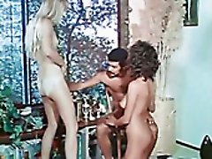 Short haired black head and pale blondie share one dick for a hot blowjob