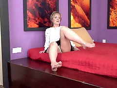 Amateur mature blonde granny Glynis strips and masturbates at home