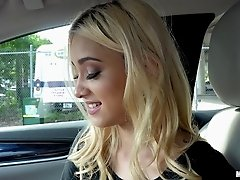 Scantily clad blonde beauty sucks a cock in the car