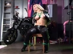 Voluptuous blonde milf in leather gets tied up to a chair
