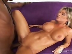 Big boobed MILF with toned body takes black cock from behind