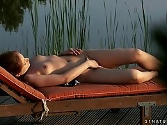 Solo small tits beauty sits outdoors and masturbates