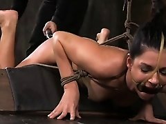 Restrained slut handling double toy penetration