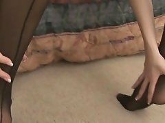 Horny girl in stockings plays with her dildo