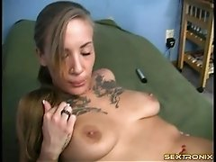 Amateur with an amazing tattooed chest and sexy tits masturbates