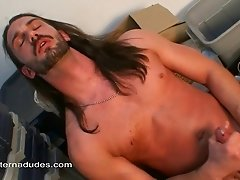 A hung gay stud with a pierced cock jerks himself off