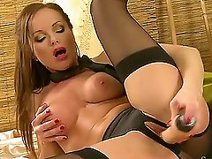 Nasty milf Silvia Saint fucks her pussy with a dildo on the sofa