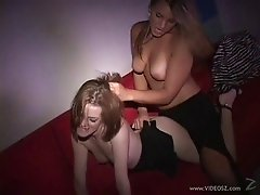 Attractive lesbian in high heels enjoying her shaved pussy being licked in the club