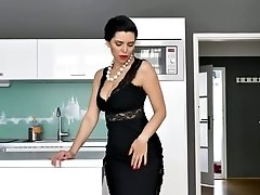 Gorgeous housewife in sexy underwear Kira Queen is masturbating pussy on the table