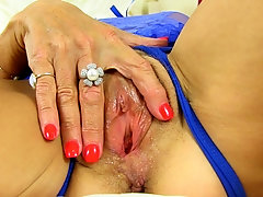 Sensual mature Georgie takes off her clothes and strokes her pussy