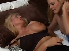 Mature blonde mom with huge knockers is finger fucked in lesbian porn clip