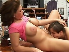 Big boobed mom moaning while getting her snatch polished on a table