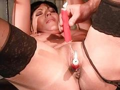 Hot brunette slave gets burned and waxed before getting whipped