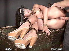 Eden Sin fed cock with only her mouth revealed in a leather mask