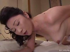 Beautiful Asian milf welcomes his cock into her cunt