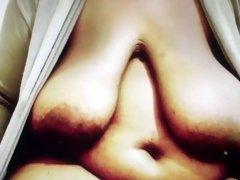 Huge Saggy African Breast