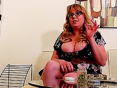 Chubby Sabina Leigh in glasses showing off her huge jugs