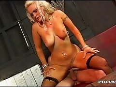 Blond milf Michelle wearing stockings rides a hard cock