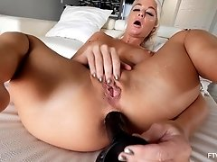 Drilling her tight butt with a long toy makes London moan loudly