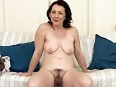 Slutty Brunette Mature Shows Her Hairy Pussy and Saggy Tits