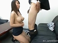 Sucking jizz out off his hard prick after he titty fucks her