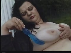 Solo fat girl masturbates in the grass