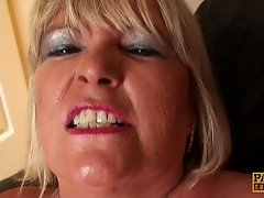 Chubby old lady pulls her panties aside and plays with her snatch