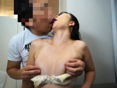 Buxom Oriental babe has a guy licking and fucking her slit