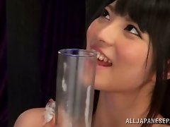 Perverted Japanese honey gathers his cum in the glass