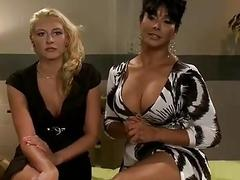 Charming shemale friends enjoy massaging and fucking on the table