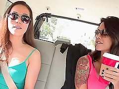 Two smoldering hot girls licking clits and tits in a car