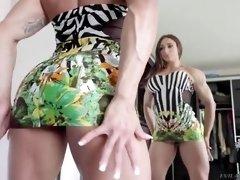 karyn bayres flexes her muscular body in front of a mirror