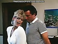 Slutty messy haired blondie Amber Lynn provides John Leslie with titfuck