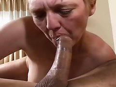 Chubby old lady showers and devours dick in a hotel bed