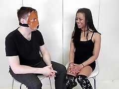 Guy with a mask talks with lovely Kira Noir about her job