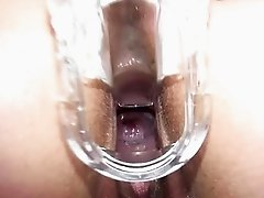 Kinky pregnant babe pussy gaped with speculum in close-up