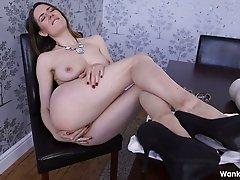 Bosomy dark haired bitch Samantha Bentley toys her kitty sitting on chair